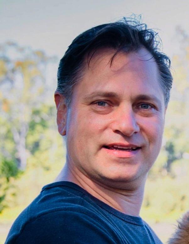 Dr. PAUL GRINEV